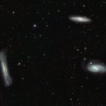 Triplet  of bright galaxies in the constellation of Leo (The Lion), together  with a multitude of fainter objects: distant background galaxies and  much closer Milky Way stars. The image hints at the power of the VST and  OmegaCAM for surveying the extragalactic Universe and for mapping the  low brightness objects of the galactic halo. This image is a composite  created by combining exposures taken through three different filters.  Light that passed through a near-infrared filter was coloured red, light  in the red part of the spectrum is coloured green, and green light is  coloured magenta.